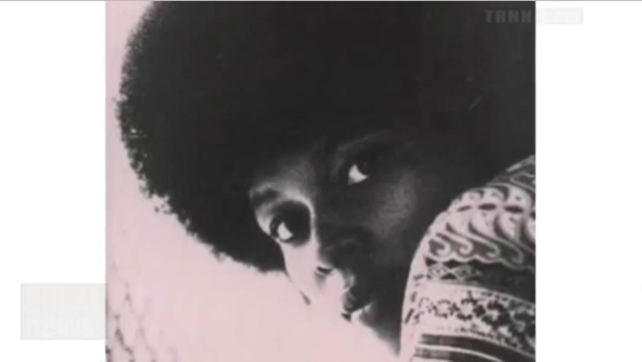 Assata Shakur, a Black woman.