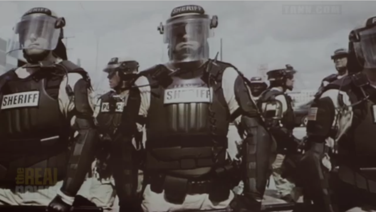 LAPD Sheriff's Department officers wearing full body armor, face plates, and other extreme military combat outfitting.